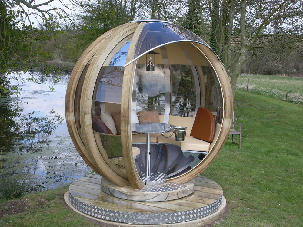 Rotating pod rotating sphere lounger for Sphere garden design